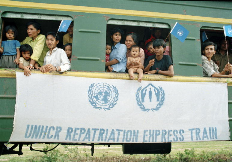Cambodians returning from refugee camps aboard a UNHCR (Office of the United Nations High Commissioner for Refugees) train.
