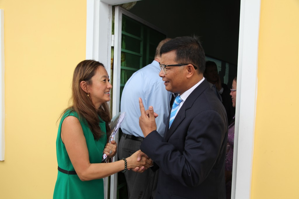 H.E. Hang Chuon Naron and Julie Chung in the inauguration of the Rice Academy, Cambodia. Photo by U.S Embassy Phnom Penh, take on 17 September 2014. Licensed under Attribution-NoDerivs 2.0 Generic