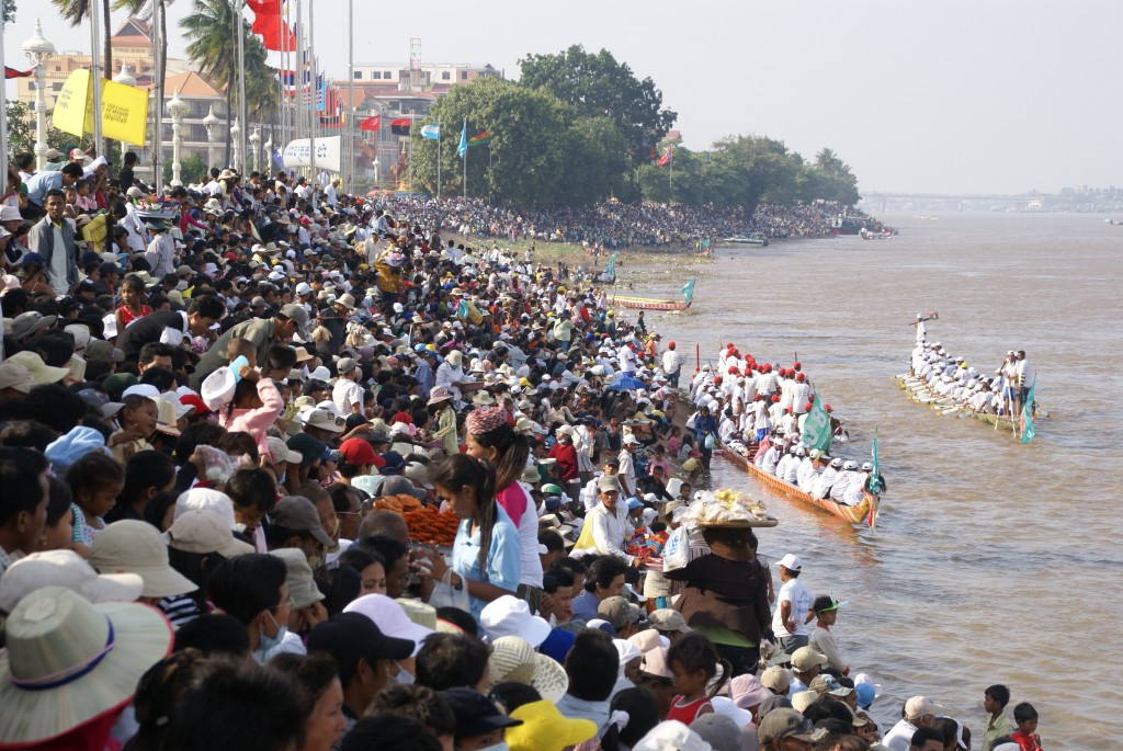 Cambodians gathering along the Chaktomuk riverside in Phnom Penh to watch boat racing during the Water Festival.