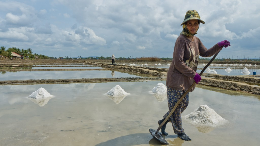 Woman working the salt fields in Kampot.