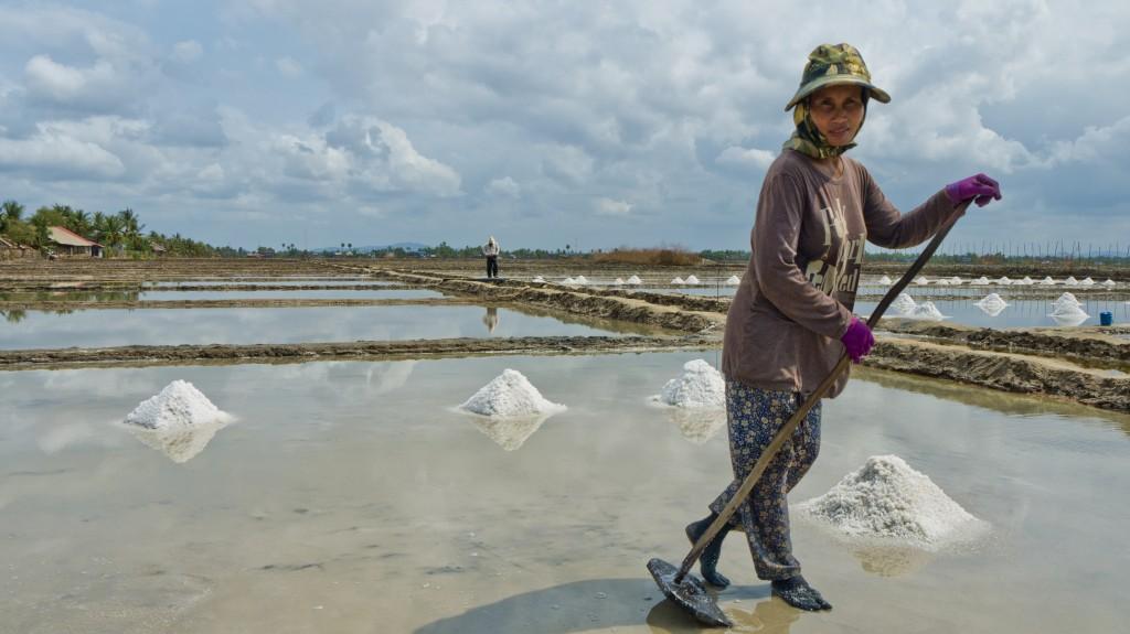 Woman working the salt fields in Kampot.