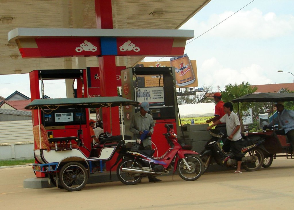 A tuk-tuk refilling gasoline. Photo by The Shifted Librarian, taken on 13 October 2008. Licensed under Creative Commons Attribution-NonCommercial-ShareAlike 2.0 Generic.