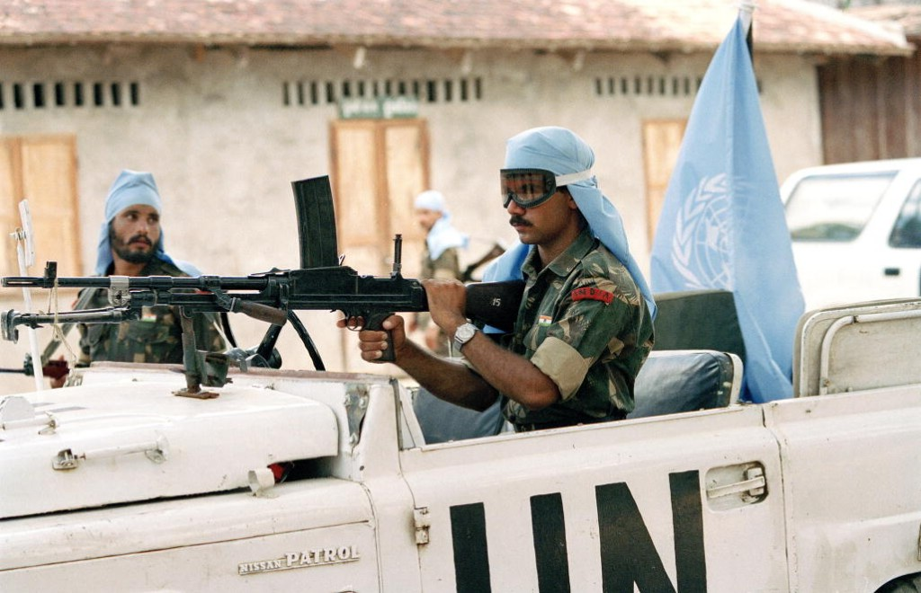 UNTAC soldiers from India patrolling the streets in Prey Veng province, Cambodia, on the second day of voting. Photo by United Nations Transitional Authority of Cambodia (UNTAC), taken on May 24 1993. Licensed under Attribution-NonCommercial-NoDerivs 2.0 Generic