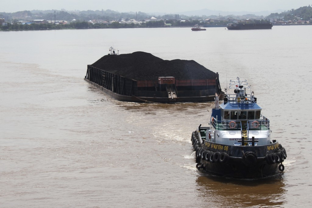 A coal barge from Samarinda coal mine on the Mahakam river. Indonesia, Borneo. June 15th 2013. Photograph: Andrew Taylor/WDM Creative Commons
