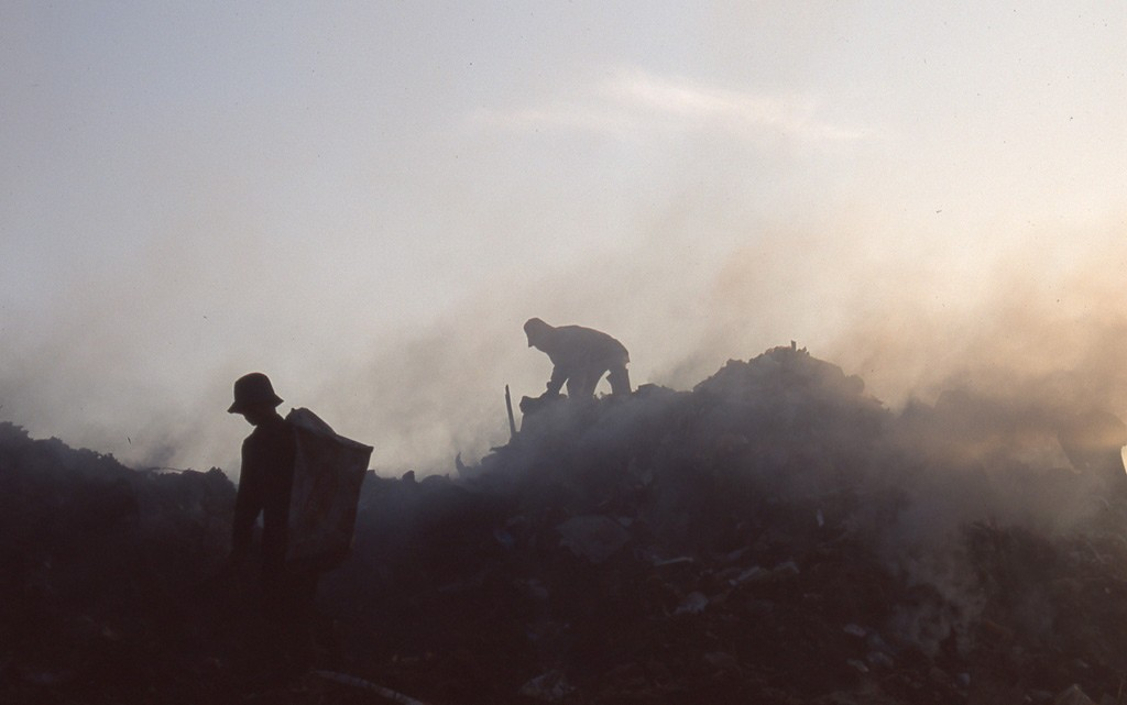 The smoke and stench blow into the air in Phnom Penh's huge landfill. Photo by Alan Morgan, taken on 17 September 2011. Licensed under CC BY-NC-ND 2.0