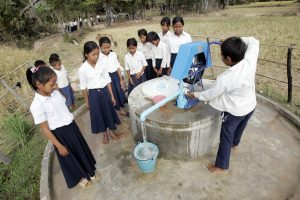 Children hand-pumping water. Photo taken by Mark Remissa, European Commission. 28 December, 2007. Licensed under (CC BY-NC-ND 2.0)